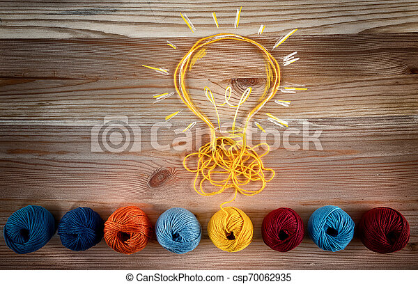 Concept of idea and innovation with wool ball. - csp70062935