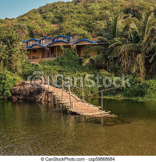 Ruined wooden bridge - csp59868684